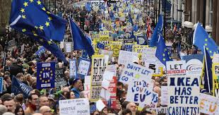 Countless people waving EU flags and anti-Brexit banners as they march in London